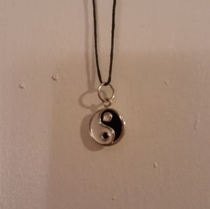 Yin yang charm necklace on black hemp cord